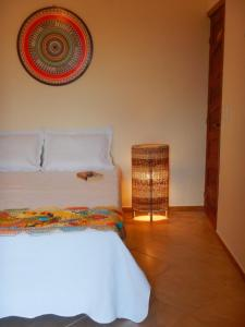 A bed or beds in a room at Pousada do Sonho
