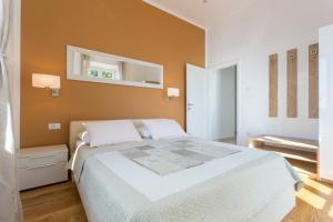 A bed or beds in a room at Apartments Villa Victoria