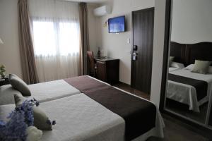 Säng eller sängar i ett rum på Arcos de Montemar