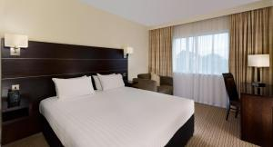 A bed or beds in a room at DoubleTree by Hilton London Heathrow Airport