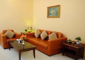 A seating area at Royal Palace Hotel Apartment Previously Tulip Inn