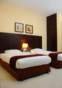 A bed or beds in a room at Royal Palace Hotel Apartment Previously Tulip Inn