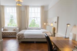 Een bed of bedden in een kamer bij Landgoed Huize Glory