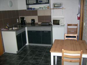 Küche/Küchenzeile in der Unterkunft Ferienwohnung Clauss