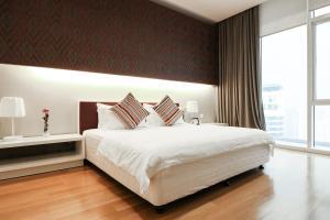Un ou plusieurs lits dans un hébergement de l'établissement Victoria Home Platinum Suites