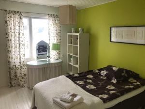 Vuode tai vuoteita majoituspaikassa Rantolan B&B