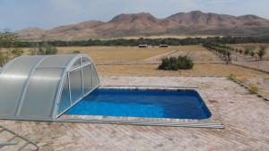 The swimming pool at or near Ukuib Guest Farm and Camping