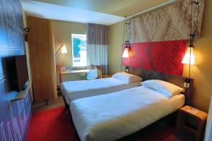 伊爾庫茨克中心宜必思酒店房間的床