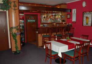 The lounge or bar area at Penzion U Zvonu