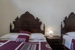 Uma cama ou camas num quarto em Veneza