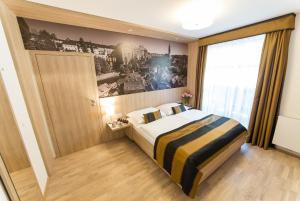 Łóżko lub łóżka w pokoju w obiekcie Garni hotel Castle Bridge