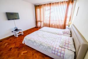 A bed or beds in a room at Studio Oceano