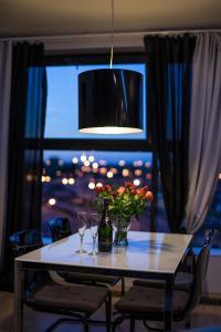 Telewizja i/lub zestaw kina domowego w obiekcie Nights Apartments
