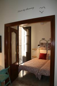 Cama o camas de una habitación en Alcaiceria