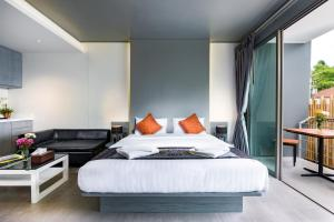 A bed or beds in a room at Kamala Resotel