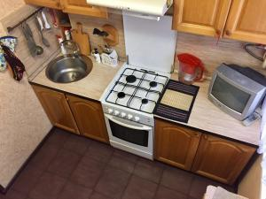 A kitchen or kitchenette at 2-Двух комнатная Ванцетти
