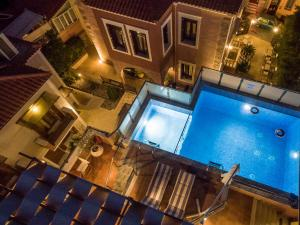 A view of the pool at Theofilos Paradise Boutique Hotel or nearby