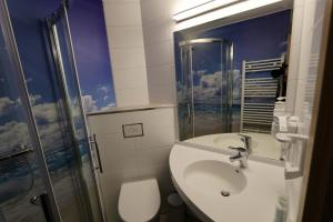 Ein Badezimmer in der Unterkunft Hotel Sonnekalb