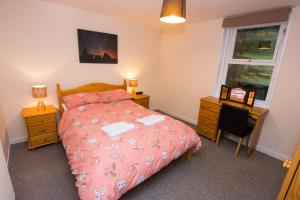 A bed or beds in a room at Bayview Self-Catering, Lerwick