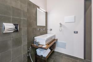 A bathroom at I Mori - Design Apartments