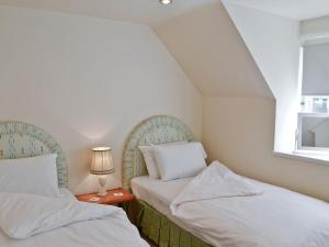 A bed or beds in a room at Hearthstanes Steading