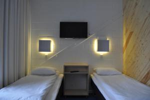 Voodi või voodid majutusasutuse Pärnu Rannastaadioni Hostel toas