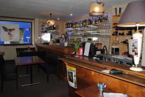 The lounge or bar area at Taverne de la paix