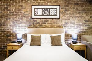 A bed or beds in a room at The Lodge by Haus