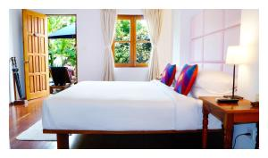 A bed or beds in a room at Oasis Hotel