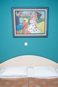 Кровать или кровати в номере Hotel Niski Cvet