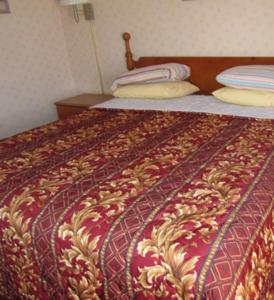 A bed or beds in a room at Budget Inn Motel Dalhart