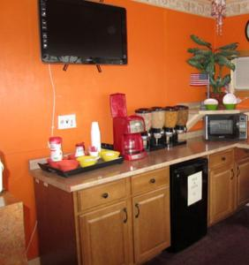 A television and/or entertainment center at Budget Inn Motel Dalhart