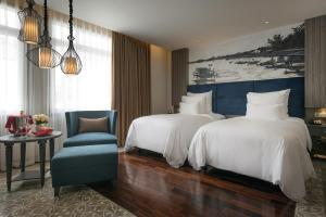 Un ou plusieurs lits dans un hébergement de l'établissement Paradise Suites Hotel