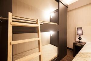 A bunk bed or bunk beds in a room at The Centurion Classic Akasaka