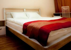 A bed or beds in a room at Park Hotel Veles