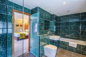 A bathroom at Owston Hall Hotel