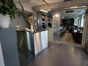 Een restaurant of ander eetgelegenheid bij Hotel Orchidee