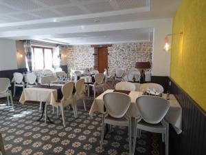 A restaurant or other place to eat at L'auberge Des 3 Ponts