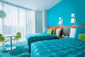 A bed or beds in a room at Universal's Cabana Bay Beach Resort