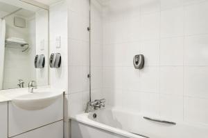 A bathroom at Days Inn Kendal - Killington Lake