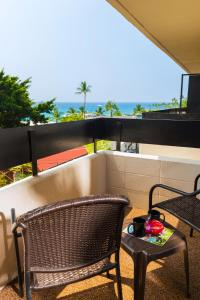 A balcony or terrace at Kona Seaside Hotel