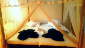 A bed or beds in a room at Ella Village Inn