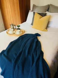 A bed or beds in a room at Boutique Studio On Bondi Beach