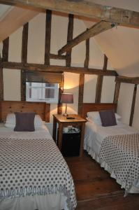 A bed or beds in a room at Lancasters Guest House