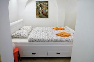 Un ou plusieurs lits dans un hébergement de l'établissement Apartment at the Golden Ram