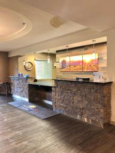 The lobby or reception area at Days Inn & Suites by Wyndham Brooks