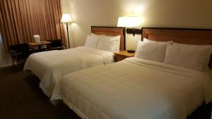 A bed or beds in a room at Japan House Suites