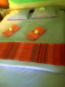 Un ou plusieurs lits dans un hébergement de l'établissement Anouxa Riverview Guesthouse
