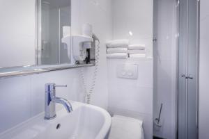 Un baño de Hotel Victorie