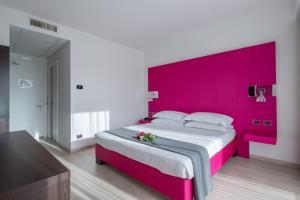 Letto o letti in una camera di Hotel Brandoli